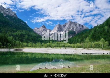 View of the Julian Alps from Kranjska Gora with Jasna Lake in Slovenia - Stock Photo