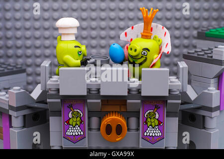 Tambov, Russian Federation - July 20 2016 Lego King Pig with blue egg and Chef Pig with pan standing on King Pigs - Stock Photo