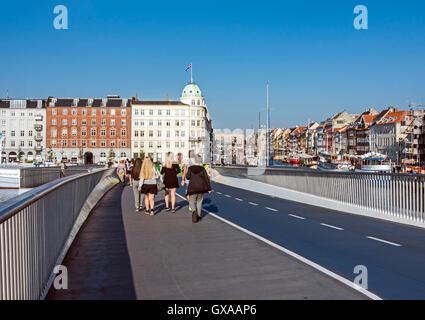 New pedestrian and bicycle bridge Inderhavnsbroen connecting Kongens Nytorv and Christianshavn via Nyhavn in Copenhagen - Stock Photo