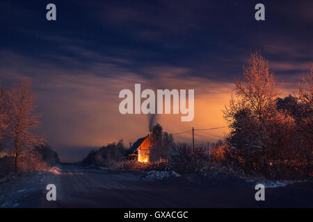 winter night light house fire - Stock Photo