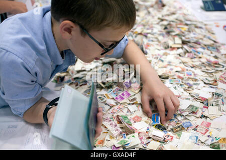 World Stamp Show-NY 2016 youth section for young stamp collectors in the NYC Javits Convention Center. - Stock Photo