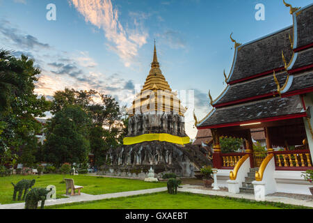Wat Chiang Man at sunset, the oldest temple in Chiang Mai, Thailand. - Stock Photo