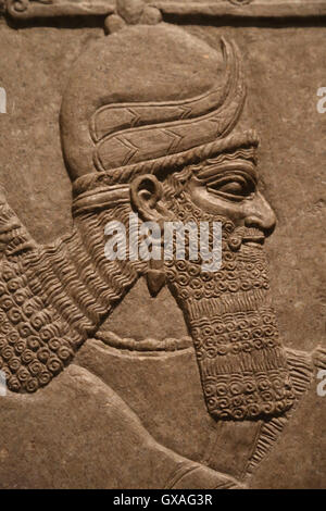 Relief with winded genius. 9th century BC. Neo-Assyrian. Reign of Ashurnasirpal. Nimrud (ancient Kalhu). Northern - Stock Photo