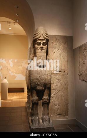 Human-headed winged lion (lamassu). 883-859 BC. Neo-Assyrian. Reign of Ashurnasirpal. Nimrud (ancient Kalhu). Mesopotamia. - Stock Photo