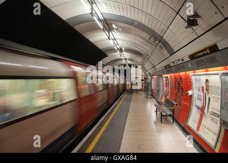 London, UK 04 March, 2016. The Tube. Green Park Station. The hurtling train in tunnel. - Stock Photo