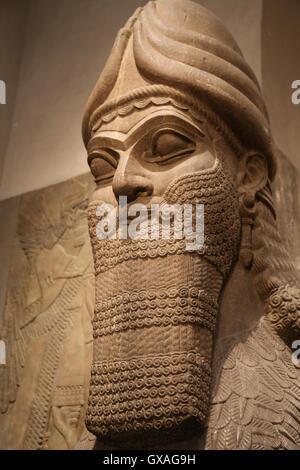 Human-headed winged lion (lamassu). 883-859 BC. Neo-Assyrian. Reign of Ashurnasirpal. Nimrud (ancient Kalhu). - Stock Photo