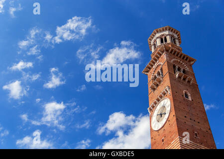 Close-up view on Lamberti tower with clock in Verona city in Italy - Stock Photo