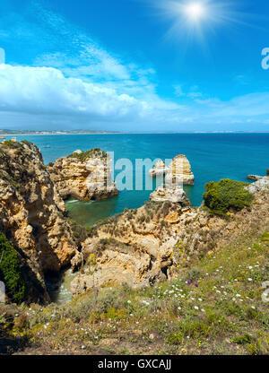 Sunshine above  Atlantic ocean summer rocky coastline (Ponta da Piedade, Lagos, Algarve, Portugal). - Stock Photo