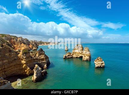 Sunshine above  rock formations along coastline (Ponta da Piedade, Lagos, Algarve, Portugal). - Stock Photo
