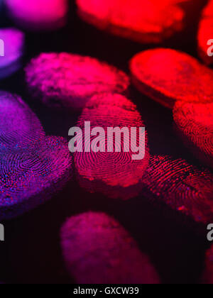 Identity, human finger prints shown up using light - Stock Photo