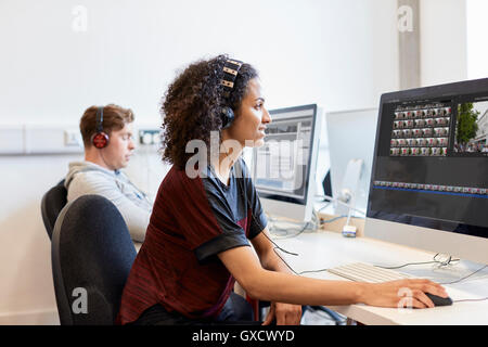 Young female computer aided designer working on computer in design studio - Stock Photo