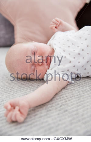 Sleeping baby girl, arm outstretched - Stock Photo