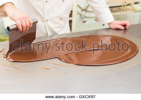 Chef tempering chocolate - Stock Photo