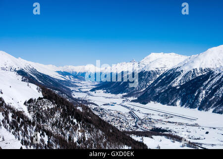 Snow covered mountain valley, Engadin, Switzerland - Stock Photo