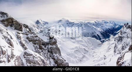 Snow covered landscape and low cloud, Mount Titlis, Switzerland - Stock Photo