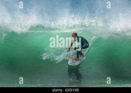 A surfer in spectacular action at Fistral in Newquay, Cornwall. UK. - Stock Photo