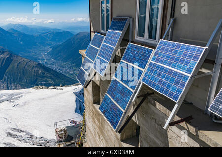 Solar panels on side of building, French Alps - Stock Photo