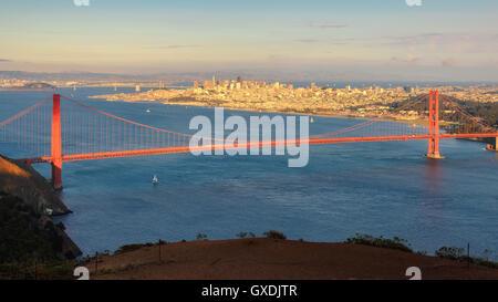 San Francisco Panorama view Golden Gate Bridge from San Francisco Bay at sunset - Stock Photo