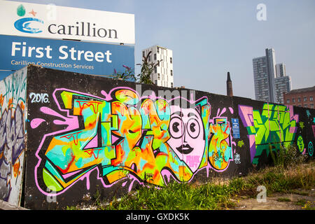 First Street Carillon developments, hoardings, muraks and high-rise buildings in the Castlefield area of 1st Street - Stock Photo