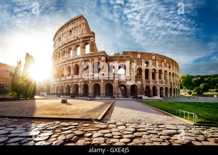 Colosseum in Rome and morning sun, Italy - Stock Photo