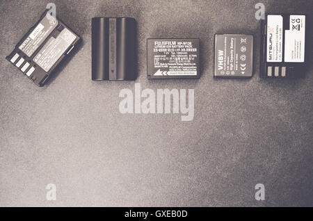 spare camera batteries on a slate worktop - Stock Photo