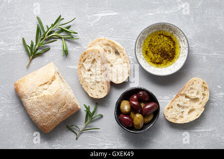 Ciabatta bread with olives, oil and herbs - Stock Photo