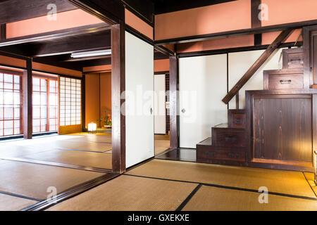 Japan, Izushi. Izushi Shiryokan museum, interior. Two tatami mat Meiji period rooms with open sliding screens between - Stock Photo