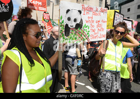 Thousands of protestors march to Parliament under the banner 'No More Austerity, No To Racism, Tories Out', organised - Stock Photo