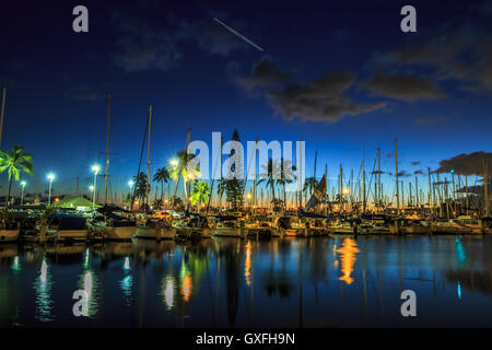 Honolulu Harbor by night - Stock Photo