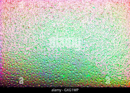 Colorful beads of frozen water after a sleet storm create interesting ice patterns on the exterior metal finish - Stock Photo