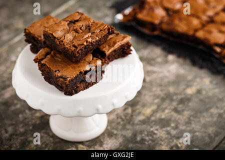 homemade chocolate brownies on a dessert plate - Stock Photo