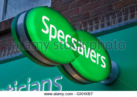 Signs on a Specsavers opticians retail store in Huntingdon High Street - Stock Photo