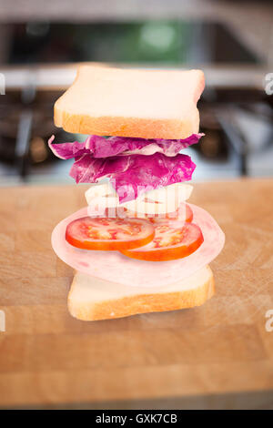 Ham sandwich with ingredients floating - Stock Photo