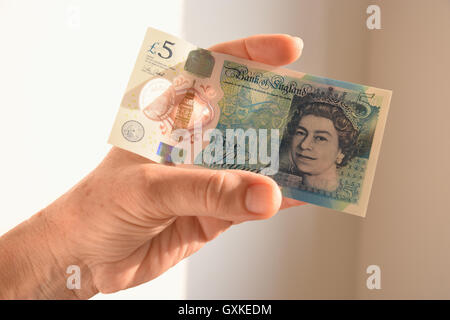 The new Polymer UK Five Pound Note - Stock Photo
