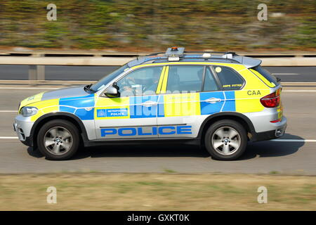 Police car driving near London Heathrow Airport, UK - Stock Photo