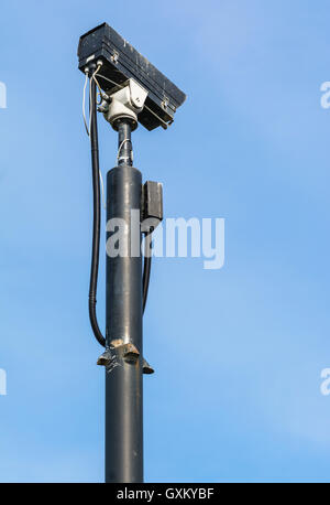 CCTV security camera mounted on a tall pole. - Stock Photo