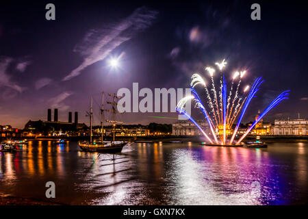 London, United Kingdom - September 16, 2016: Fireworks display at Tall Ships Festival in Greenwich, with Royal Naval - Stock Photo