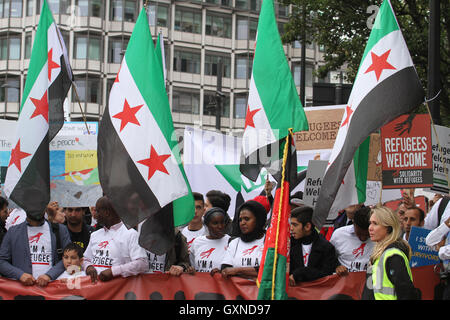 LONDON, UK - September 17: Thousands of people march through London to show solidarity with Refugees on 17 September - Stock Photo