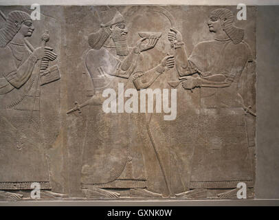 Relief King Ashurnasirpal II with ceremonial bowl. 883-859 B.C. Neo-Assyrian. Reign of Ashurnasirpal. Nimrud. Mesopotamia. - Stock Photo