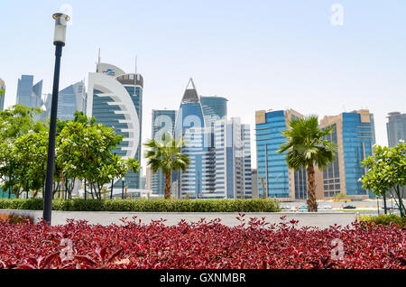 Skyline of West Bay financial district in Doha, Qatar, from the green Sheraton park - Stock Photo