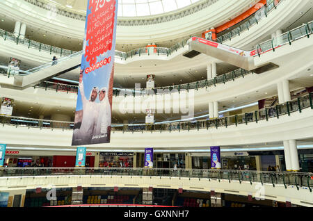 Ooredoo ad in the middle of the Doha City Center, a large mall in Qatar - Stock Photo