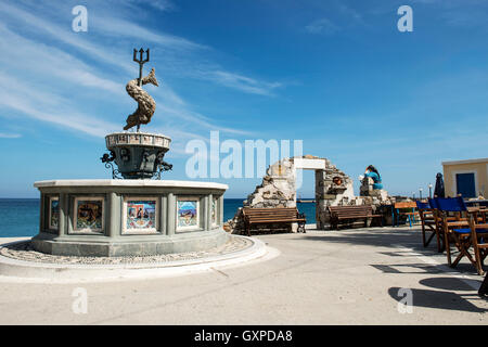 Fountain of Neptune in Diafani, a tranquil holiday seaside village on the island of Karpathos, Dodecanese islands, - Stock Photo
