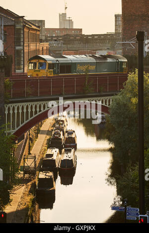 Manchester castleield canal railway    elevated railway viaduct bridge city centre through  architecture golden - Stock Photo