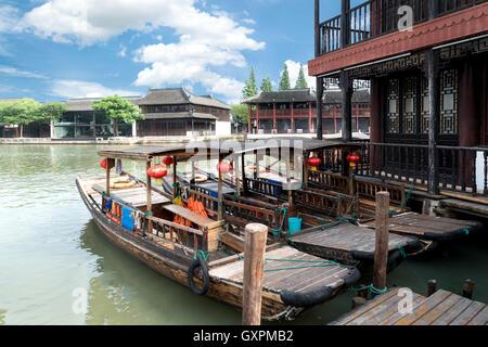 China traditional tourist boats on canals of Shanghai Zhujiajiao Water Town in Shanghai, China - Stock Photo
