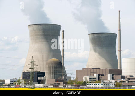 Nuclear power plant with yellow field and big blue clouds in Germany. - Stock Photo