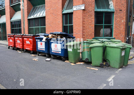 A collection of wheeliebins in Manchester City centre. - Stock Photo