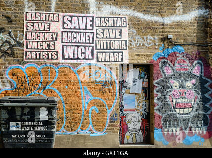 Protest posters against demolition of artist studios in Hackney Wick, East London, by the London Legacy Development - Stock Photo