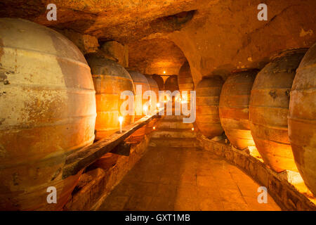 Antique winery in Spain with clay amphora pots - Stock Photo