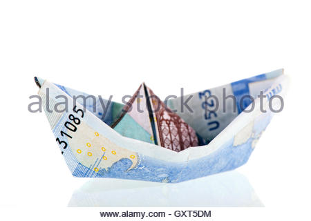 boat from bank notes - Stock Photo
