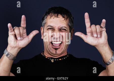 Man making devil sign - Stock Photo